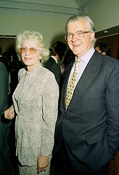 MR & MRS KENNETH BAKER he was the Tory government minister, at a party in London on 11th June 1997.LZG 17