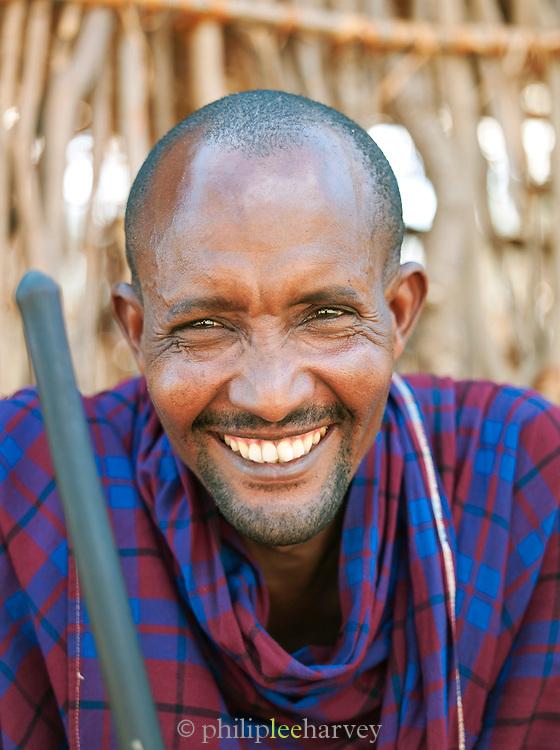Maasai tribesman laughing, near Amboseli National Park, Rift Valley Province, Kenya