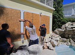 From left, JC Abreu, Peter Gonzalez, and Jorge Abreu with Hurricane Busters Enterprises install hurricane shutters at a home in Key Largo, FL, USA, in preparation for Hurricane Irma on Wednesday, September 6, 2017. Photo by Al Diaz/Miami Herald/TNS/ABACAPRESS.COM