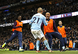 Manchester City's David Silva celebrates scoring his side's second goal of the game with team mate Vincent Kompany (right) during the Premier League match at the Etihad Stadium, Manchester.
