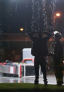 6/8/08 Omaha, NEStorm damage from a possible  tornado in Millard area 132nd and Q streets..Bucky's Amoco, according to firefighters on scene, the man with his hands on his head is an employee of the station as he looks at blown over gas pump..No one was in the station at the time of the storm..(chris machian/Omaha World Herald)
