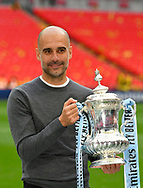 Manchester City manager Pep Guardiola holds The FA Cup during the The FA Cup Final match between Manchester City and Watford at Wembley Stadium, London, England on 18 May 2019.