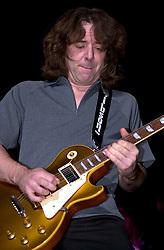 Thunder Guitarist Ben Matthews on stage at Monsters of Rock. Last night of an eleven date tour at the Hallam FM Arena, Sheffiel Tuesday 26th November 2002<br /> <br /> Copyright Paul David Drabble<br /> Freelance Photographer<br /> 07831 853913<br /> 0114 2468406<br /> www.pauldaviddrabble.co.uk<br /> [#Beginning of Shooting Data Section]<br /> Nikon D1 <br /> 2002/11/26 20:13:58.4<br /> JPEG (8-bit) Fine<br /> Image Size:  2000 x 1312<br /> Color<br /> Lens: 80-200mm f/2.8-2.8<br /> Focal Length: 135mm<br /> Exposure Mode: Manual<br /> Metering Mode: Spot<br /> 1/250 sec - f/2.8<br /> Exposure Comp.: 0 EV<br /> Sensitivity: ISO 400<br /> White Balance: Auto<br /> AF Mode: AF-S<br /> Tone Comp: Normal<br /> Flash Sync Mode: Front Curtain<br /> Auto Flash Mode: External<br /> Color Mode: <br /> Hue Adjustment: <br /> Sharpening: Normal<br /> Noise Reduction: <br /> Image Comment: <br /> [#End of Shooting Data Section]