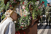 Moscow, Russia, 02/08/2006..A woman kisses an ikon of Saint Ilyin carried by paratroopers as Russian Orthodox believers celebrate Saint Ilyin's Day in and around Red Square..