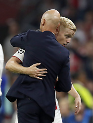 (L-R) Ajax coach Erik ten Hag, Donny van de Beek of Ajax during the UEFA Champions League play offs round first leg match between Ajax Amsterdam and Dynamo Kyiv at the Johan Cruijff Arena on August 22, 2018 in Amsterdam, The Netherlands