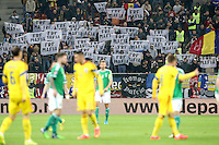 """ROMANIA, Bucharest : Romania's fans display banners which reads """"FRF MAFIA"""" (FRF means Romanian Footballl Federation) during the Euro 2016 Group F qualifying football match Romania vs Northern Ireland in Bucharest, Romania on November 14, 2014."""