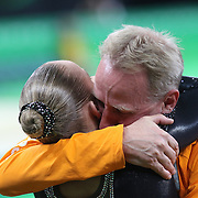Gymnastics - Olympics: Day 10  Sanne Wevers of The Netherlands is hugged by her father and coach Vincent Wevers after winning the gold medal in the Women's Balance Beam Final during the Artistic Gymnastics competition at the Rio Olympic Arena on August 15, 2016 in Rio de Janeiro, Brazil. (Photo by Tim Clayton/Corbis via Getty Images)