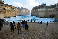 On a cold winter day, tourists visit Loch Ard Gorge, one of the landmarks on the Great Ocean Road in Australia.