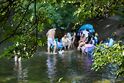 People enjoy the hot weather in the River Lea in east London on Friday, Aug 7, 2020, as the UK could see record-breaking temperatures with forecasters predicting Friday as the hottest day of the year. (VXP Photo/ Vudi Xhymshiti)