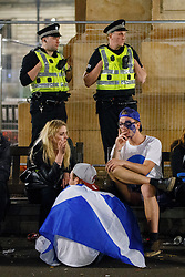 © Licensed to London News Pictures. 19/09/2014. Glasgow, UK. Disappointed 'Yes' voters and campaigners reacting to Scotland's decision to stay in the union at George Square in Glasgow on Friday, 19 September 2014, after the Scottish independence referendum. Photo credit : Tolga Akmen/LNP