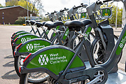 A line of West Midlands Cycle Hire Bicycle in central Coventry 8th of April 2021, Coventry, United Kingdom.