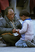 Families wait outside the Buddhist Association office - Ley Ladakh 2006