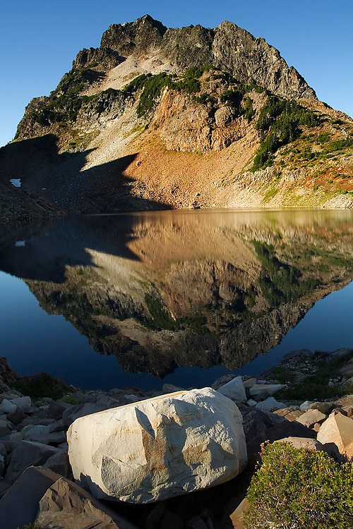 Del Campo Peak is reflected in Foggy Lake, Gothic Basin, Mount Baker-Snoqualmie National Forest, Washington.