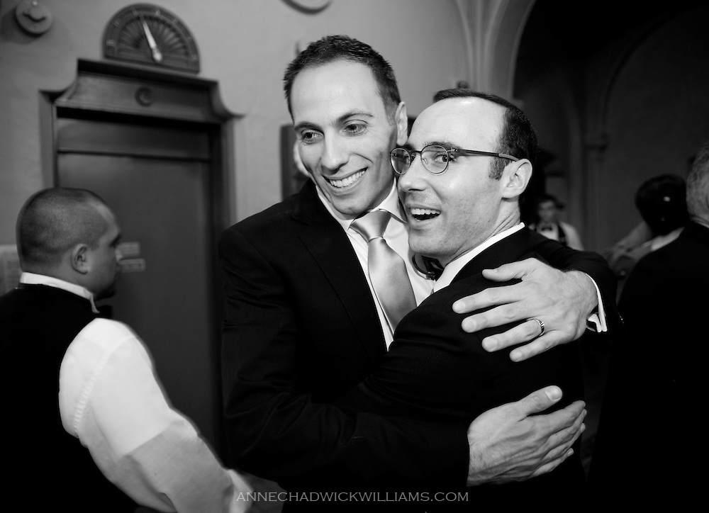 A groom hugs a friend during his wedding reception at the Berkeley City Club.