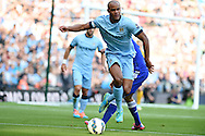 Vincent Kompany of Man city in action. Barclays premier league match, Manchester city v Chelsea at the Etihad stadium in Manchester,Lancs on Sunday 21st Sept 2014<br /> pic by Andrew Orchard, Andrew Orchard sports photography.