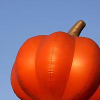 USA, California, San Diego. An inflated pumpkin against the sky.