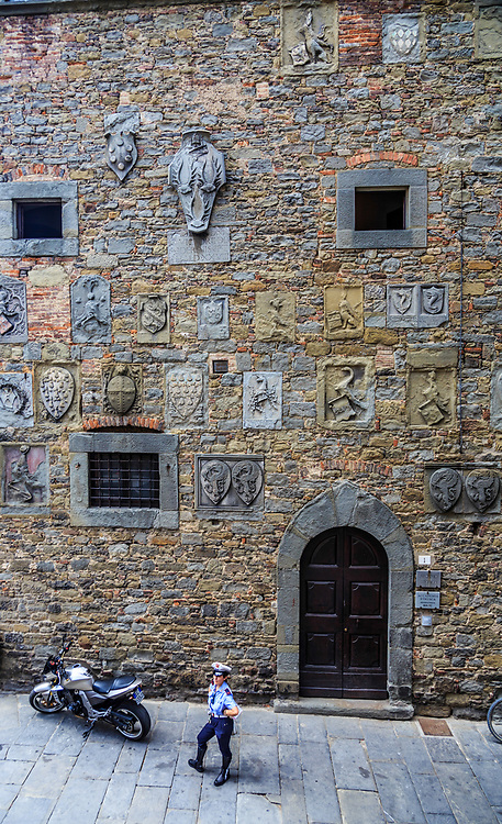 The coats of arms in the wall of Palazzo Casalli in Cortona, Italy. After 1411 the palazzo was named Palazzo Pretorio and occupied by the city's Florentine captains. The coats of arms of these captains are still visible on the right hand façade of the building, on Via Casali, which has remained virtually unaltered.