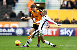 Conor Coady of Wolverhampton Wanderers passes the ballot has it blocked by Johnny Russell of Derby County - Mandatory by-line: Robbie Stephenson/JMP - 05/11/2016 - FOOTBALL - Molineux - Wolverhampton, England - Wolverhampton Wanderers v Derby County - Sky Bet Championship