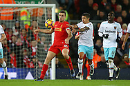 Jordan Henderson of Liverpool shields the ball from Manuel Lanzini of West Ham United.Premier League match, Liverpool v West Ham Utd at the Anfield stadium in Liverpool, Merseyside on Sunday 11th December 2016.<br /> pic by Chris Stading, Andrew Orchard sports photography.