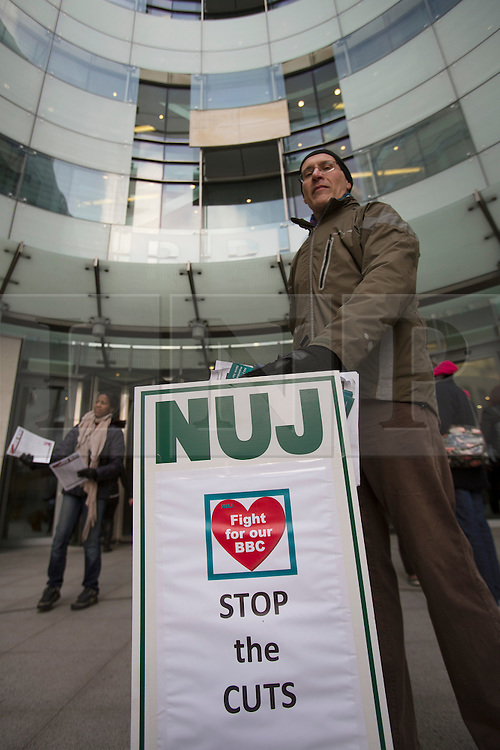© licensed to London News Pictures. London, UK 18/02/2013. Members of The National Union of Journalists (NUJ) picketing outside Broadcasting House in London as they stage one-day strike against the corporation as part of a campaign against compulsory redundancies. Photo credit: Tolga Akmen/LNP