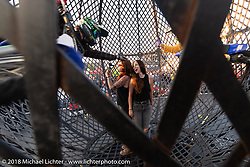 Kristen Lassen and Savannah Rose inside the Globe of Death with the Ives Brothers stunt team at the Harley-Davidson Museum, where the multi-acre campus acted as the central rally point during the Harley-Davidson 115th Anniversary Celebration event. Milwaukee, WI. USA. Thursday August 30, 2018. Photography ©2018 Michael Lichter.