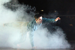 "© Licensed to London News Pictures. 14/01/2015. London, England. Marc Galvez perfoming. Dress rehearsal of ""Young Men"" by BalletBoyz the Talent. ""Young Men"" is a brand new work from BalletBoyz which premieres at Sadler's Wells on 14 January 2015 and simulaneously opens Sadler's 2015 programme. ""Young Men"" is a moving portrayal of love, friendship, losss and survival and explores the theme of war and the bonds that develop between the young men who are utterly consumed by it. Produced by BalletBoyz artistic director Michael Nunn and William Trevitt, choreography by Ivan Perez, newly commissioned score by Keaton Henson which is performed live onstage by a 12-strong band of musicians. Dancers: Andrea Carrucciu, Dalma Doman, Simone Donati, Flavien Esmieu, Marc Galvez, Adam Kirkham, Edward Pearce, Leon Poulton, Matthew Rees, Matthew Sandiford, Bradley Waller and Jennifer White. Photo credit: Bettina Strenske/LNP"