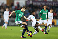 Jonny Evans of West Bromwich Albion gets to the ball ahead of Nathan Dyer of Swansea city. .Premier league match, Swansea city v West Bromwich Albion at the Liberty Stadium in Swansea, South Wales on Saturday 9th December 2017.<br /> pic by  Andrew Orchard, Andrew Orchard sports photography.