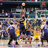 03 August 2014: Jump ball between Connecticut Sun forward Chiney Ogwumike (13) and Los Angeles Sparks forward Nneka Ogwumike (30) during the Los Angeles Sparks 70-69 victory over the Connecticut Sun, at the Staples Center, Los Angeles, California, USA.