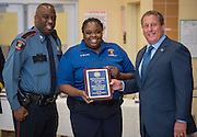 Officer Willie Demby, right, and Borita Williams, center, receive the Life Saving award from Chief Robert Mock, right, during the Houston ISD Police awards banquet at Thompson Elementary School, August 15, 2014.