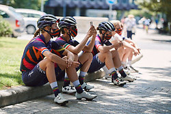 Hannah Barnes (GBR) relaxes in the shade with her CANYON//SRAM Racing teammates at the 2020 Clasica Feminas De Navarra, a 122.9 km road race starting and finishing in Pamplona, Spain on July 24, 2020. Photo by Sean Robinson/velofocus.com