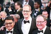 Ronaldo Del Carmen, Director Pete Docter and John Lasseter at the gala screening for the film Inside Out at the 68th Cannes Film Festival, Monday May 18th 2015, Cannes, France