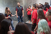 Monica Nezzer and Patrick Arite (black shirts) talk with prospective students while giving a campus tour on Thursday June 2, 2016. Arite and Nezzers are both students at the University of New Mexico and are working 15-30 hours per week giving campus tours in order to help put themselves through college. (Steven St. John for NPR)