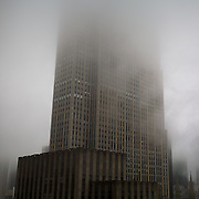 Comcast building in New York City is shrouded in fog.  Formerly the General Electric GE headquarters in Rockefeller Center