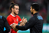 """Gareth Bale, left, of Wales national football team shakes hands with Luis Suarez of Uruguay national football team in their final match during the 2018 Gree China Cup International Football Championship in Nanning city, south China's Guangxi Zhuang Autonomous Region, 26 March 2018.<br /> <br /> Edinson Cavani's goal in the second half helped Uruguay beat Wales to claim the title of the second edition of China Cup International Football Championship here on Monday (26 March 2018). """"It was a tough match. I'm very satisfied with the result and I think that we can even get better if we didn't suffer from jet lag or injuries. I think the result was very satisfactory,"""" said Uruguay coach Oscar Tabarez. Wales were buoyed by a 6-0 victory over China while Uruguay were fresh from a 2-0 win over the Czech Republic. Uruguay almost took a dream start just 3 minutes into the game as Luis Suarez's shot on Nahitan Nandez cross smacked the upright. Uruguay were dealt a blow on 8 minutes when Jose Gimenez was injured in a challenge and was replaced by Sebastian Coates. Inter Milan's midfielder Matias Vecino of Uruguay also fired at the edge of box from a looped pass but only saw his attempt whistle past the post. Suarez squandered a golden opportunity on 32 minutes when Ashley Williams's wayward backpass sent him clear, but the Barca hitman rattled the woodwork again with goalkeeper Wayne Hennessey well beaten."""