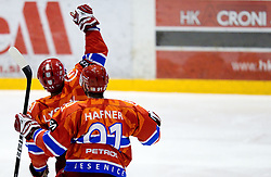 Brett Lysak of Acroni Jesenice and Tomi Hafner of Acroni Jesenice celebrate during ice-hockey match between HK Acroni Jesenice and HD Tilia Olimpija in 11th Round of EBEL league, on October 15, 2010 at Podmezakla, Jesenice, Slovenia. (Photo By Vid Ponikvar / Sportida.com)