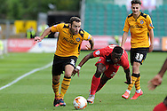 Danny Holmes of Newport county makes a break. Skybet football league two match, Newport county v York city at Rodney Parade in Newport, South Wales on Saturday 5th Sept 2015.  pic by Andrew Orchard, Andrew Orchard sports photography.