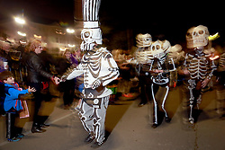 13 Feb 2015. New Orleans, Louisiana.<br /> Mardi Gras. Walking with the Skeleton Krewe along Magazine Street as the Krewe D'Etat rolls.<br /> Photo; Charlie Varley/varleypix.com