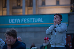 © Licensed to London News Pictures.  22/06/2021. London, UK. Fans react to the EURO 2020 England v Czech match seen on a large screens in Trafalgar Square, central London. Photo credit: Marcin Nowak/LNP