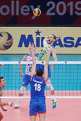 PARIS, FRANCE - SEPTEMBER 29: Tine Urnaut #17 of Slovenia spikes the ball against Marko Podrascanin #18 of Serbia during the EuroVolley 2019 Final match between Serbia and Slovenia at AccorHotels Arena on September 29, 2019 in Paris, France.  Photo by Catherine Steenkeste / Sipa / Sportida