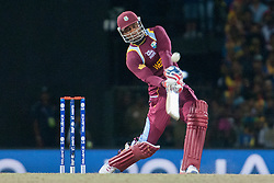 © Licensed to London News Pictures. 07/10/2012. West Indian Marlon Samuels batting during the World T20 Cricket Mens Final match between Sri Lanka Vs West Indies at the R Premadasa International Cricket Stadium, Colombo. Photo credit : Asanka Brendon Ratnayake/LNP