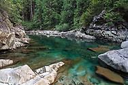 Emerald green pool along Gold Creek in Golden Ears Park near Maple Ridge, British Columbia, Canada.  The colour here is from minerals suspended in Gold Creek's water from its journey down from the surrounding mountains.