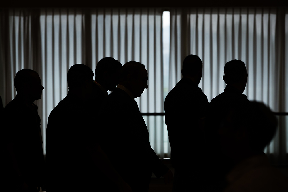 Israeli Prime Minister, Benjamin Netanyahu (C) and his bodyguards are silhouetted, following Netanyahu's address to the Jewish Agency's Board of Governors at the Knesset, Israel's parliament in Jerusalem, on November 1, 2016.
