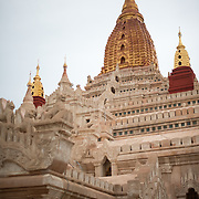 BAGAN, MYANMAR--Ananda Temple is one of the largest and most revered of the thousands of temples, pagodas, and stupas in Bagan. It dates back originally to the 11th to 12th centuries, but it has been renovated many times over the years, work that is clearly evident throughout but especially on the exterior.