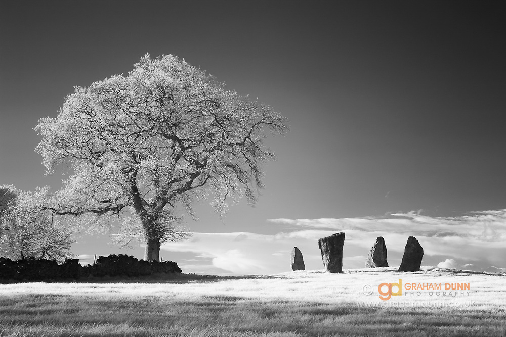 The four remaining stones of Nine Stones Close Bronze Age stone circle on Harthill Moor. Captured in infrared and converted to black & white. White Peak. Peak District National Park, Derbyshire, England, UK.