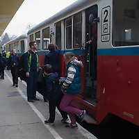 Passengers get off the train at the Huvosvolgy station of the Children's Railway in the Buda Hills in Budapest, Hungary on November 13, 2014. ATTILA VOLGYI