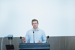 Portrait of a young student giving lecture in lecture hall, Freiburg im Breisgau, Baden-Wuerttemberg, Germany