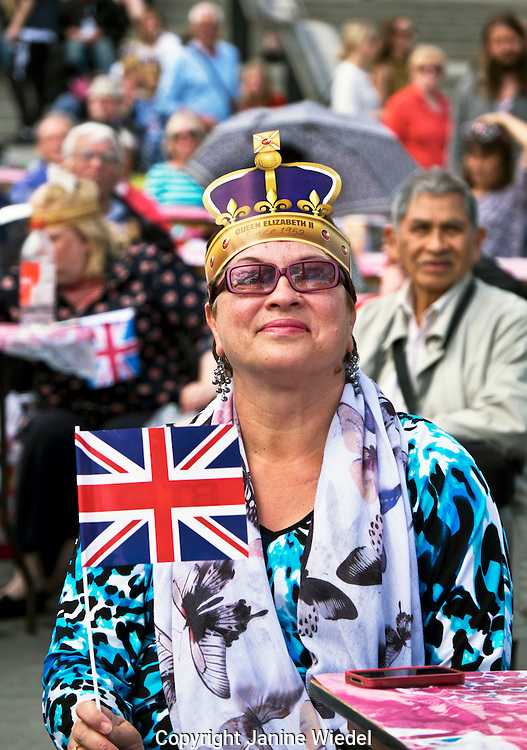People celebrating Queen Elizabeth's 90th birthday celebrations in Trafalgar Square in London