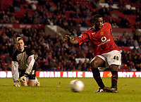 Photo: Jed Wee.<br /> Manchester Utd v Barnet. Carling Cup. 26/10/2005.<br /> <br /> Manchester United's Sylvan Ebanks-Blake (R) rounds Barnet goalkeeper Scott Tynan to score in an empty net.