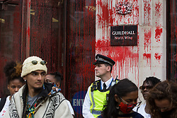 Blood-red paint sprayed on the North Wing of the Guildhall by environmental activists from Extinction Rebellion during a Blood Money March through the City of London is pictured on 27th August 2021 in London, United Kingdom. Extinction Rebellion were intending to highlight financial institutions funding fossil fuel projects, especially in the Global South, as well as law firms and institutions which facilitate them, whilst calling on the UK government to cease all new fossil fuel investment with immediate effect.