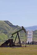 Oil Derricks near the Ira J. Chrisman Wind Gap Pumping Plant, part of the California State Water Project, is located at the southern end of the San Joaquin Valley. Water is pumped 518 feet over the Grapevine from the California Aqueduct, enroute to Los Angeles as part of its water supply. Kern County, California , USA